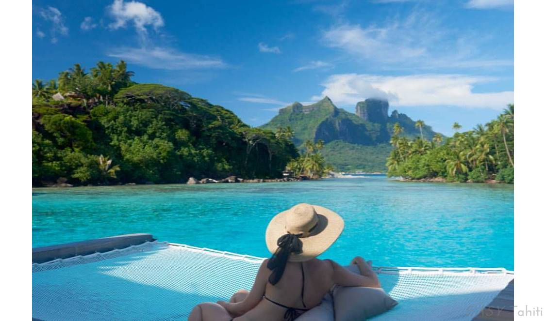 vacation in an overwater bungalow in Bora Bora